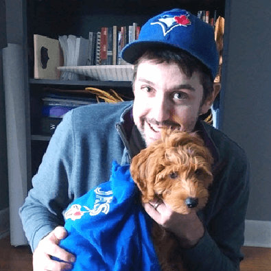 Jeff and his dog in Blue Jays gear