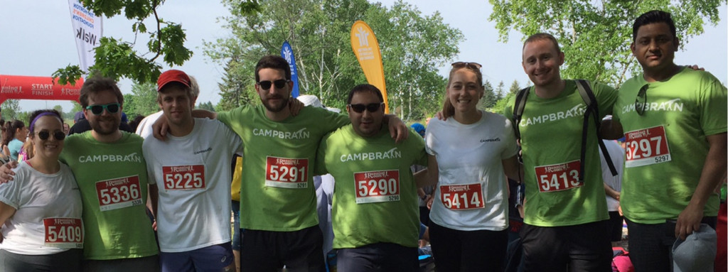 Group of people in CampBrain t-shirts with race numbers