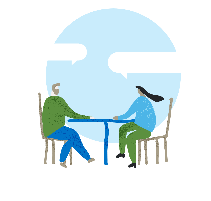 two people sitting at a table talking