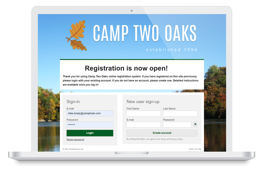 Laptop showing registration form with heading Camp Two Oaks
